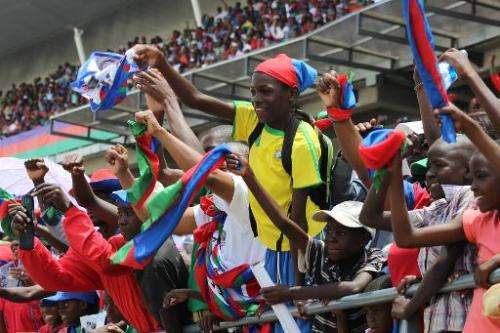 Namibian Ruling party South West Africa People Organization (SWAPO) supporters cheer during the last General Election campaign r
