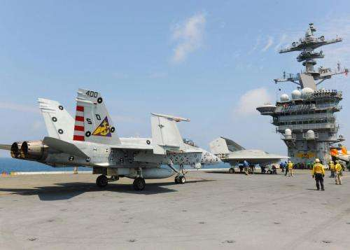 Navy tests drone landings on aircraft carrier along with manned plane