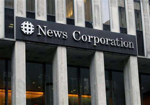 News Corp. profit drops; results top Wall Street