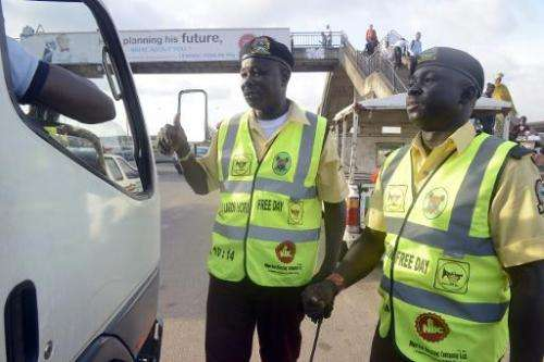 Officers of the Lagos State Traffic Management Authority (LASTMA) speak to a motorist about the use of car horn in Lagos on Octo