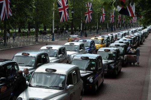 Parked taxis block the Mall leading to Buchingham Palace during a protest by London black cab drivers against private taxi servi