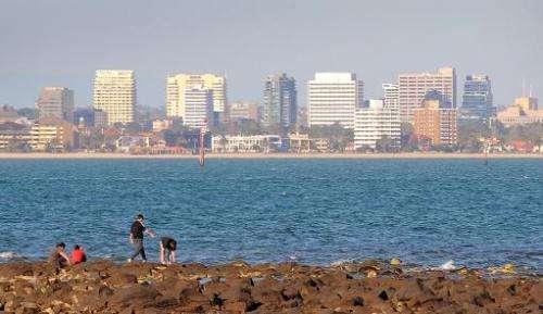 People clamber over seaside rocks in Melbourne on October 27, 2009