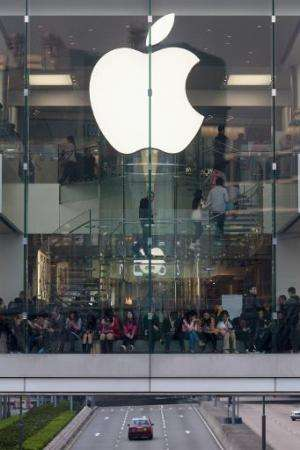People shop at an Apple store in Hong Kong, on December 25, 2013