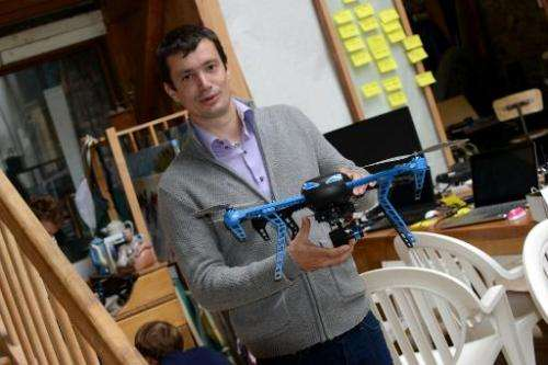 Project engineer Antoine Level shows a drone prototype named Hexo+ on July 2, 2014 in  France