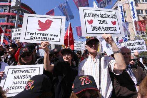 Protesters demonstrate against the ban on Twitter in Ankara on March 22, 2014