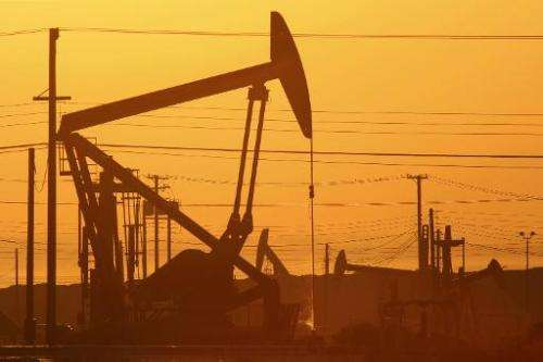 Pump jacks are seen at dawn in an oil field on March 24, 2014 near Lost Hills, California