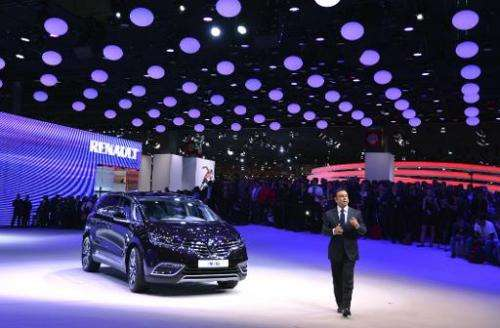 Renault CEO Carlos Ghosn presents the new Renault Espace 5 at the 2014 Paris Auto Show in Paris on October 2, 2014