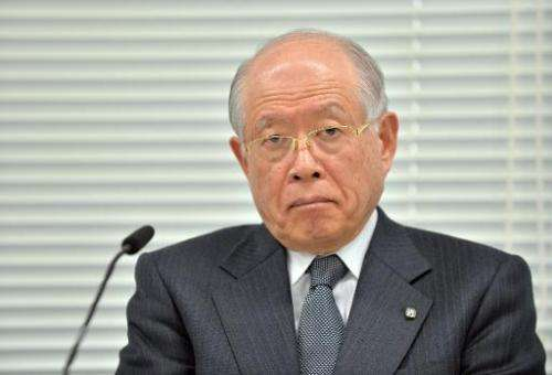 Riken institute head Ryoji Noyori listens to questions during a press conference in Tokyo on March 14, 2014