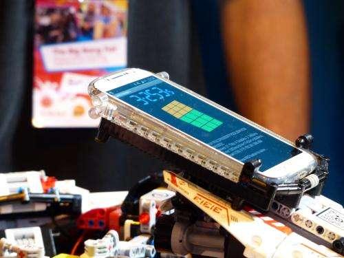 Robot solves Rubik's Cube in record time at Birmingham fair