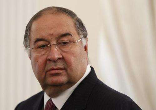 Russian businessman Alisher Usmanov attends a meeting outside of Moscow on September 12, 2013