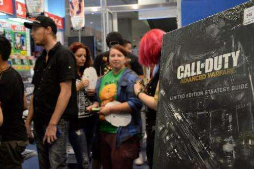 """Shoppers queue for the newest instalment of the """"Call of Duty"""" videogame ahead of the midnight launch of pre-ordered c"""