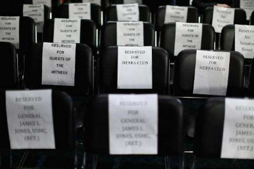 Signs reserve seats before a Senate Foreign Relations Committee hearing about the proposed Keystone XL pipeline project on Capit
