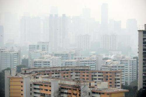 Singapore's financial business district is pictured shrouded in smog on September 15, 2014