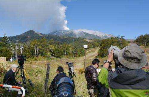 Smoke can be seen billowing from Mount Ontake in Nagano, Japan, on September 28, 2014