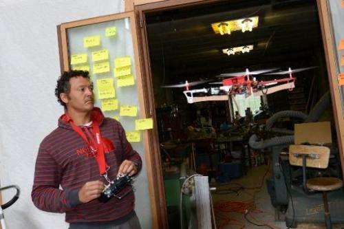 Snowboarder Xavier de le Rue tests a HEXO+ drone prototype on July 2, 2014 in France