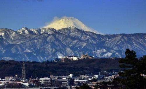Snow-covered Mount Fuji is seen from Tokyo, Japan, on February 16, 2014