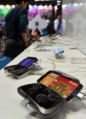 South Korean electronics giant Samsung Galaxy smartphone, with video game controler, is displayed at the annual Tokyo Game Show