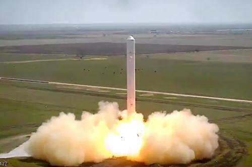SpaceX's next-generation reusable rocket roars in tie-down test