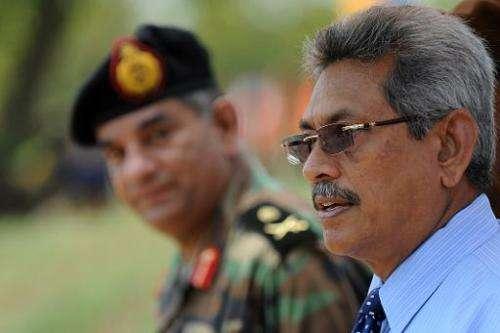 Sri Lanka''s Defence secretary Gotabhaya Rajapakse (R) in the eastern region of Thoppigala on April 18, 2013