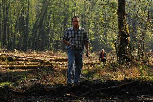 Suren Gazaryan, of the Environmental Watch on North Caucasus, walks in a forest close to the 2014 Olympics construction site nea