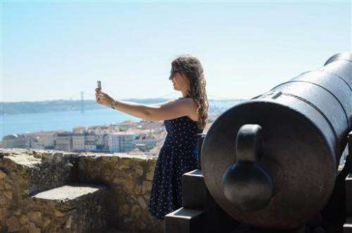 Teens love vacation selfies; adults, not so much