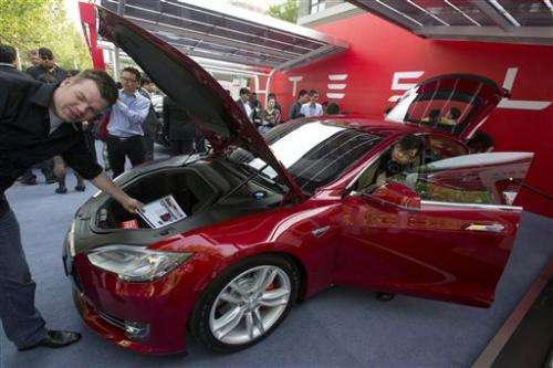 Tesla delivers first China cars, plans expansion