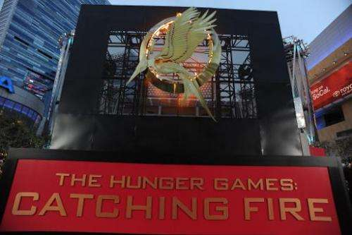 """The flaming logo for the Los Angeles premiere of """"The Hunger Games: Catching Fire"""" is seen at the Nokia Theatre LA Liv"""