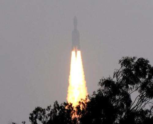 The Geostationary Satellite Launch Vehicle (GSLV) Mk-III rocket lifts off from The Satish Dhawan Space Centre on Sriharikota Isl