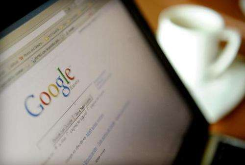 The Google website for Spain is seen on a laptop in a cafe in Granada on June 11, 2008