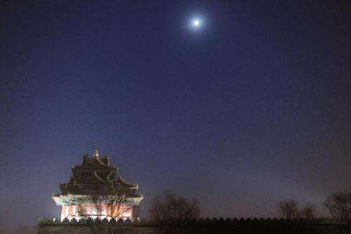 The moon shines over the Turret of Palace Museum at the Forbidden City, in Beijing, on December 13, 2013