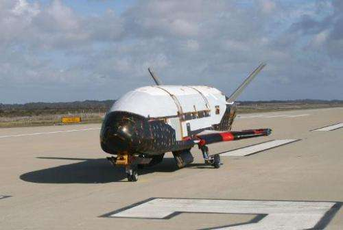 This April 4, 2010, file photo provided by the US Air Force shows the X-37B spacecraft, which is expected to land this week afte