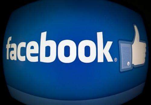 This February 25, 2013 photo taken in Washington, DC, shows the splash page for the Internet social media giant Facebook