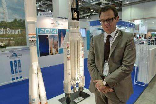 This photograph taken on June 16, 2014 shows Stephane Israel, chief exceutive of Arianespace, posing in front their booth at the