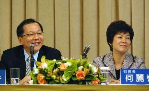 TSMC chief executive Rick Tsai (left) and chief finance officer Lora Ho listen at a quarterly report meeting in Taipei on Januar