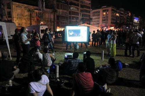 Turkish protesters watch videos from YouTube at Gundogdu Square in Izmir, on June 8, 2013