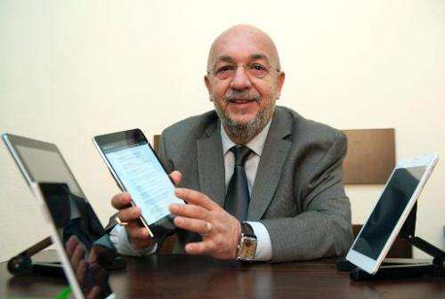 Vahan Chakarian, president of the joint Armenian-US company Minno, shows Armenia's first tablet computer, ArmTab, designed by hi