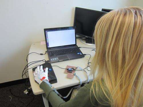 Wearable computing gloves can teach Braille, even if you're not paying attention