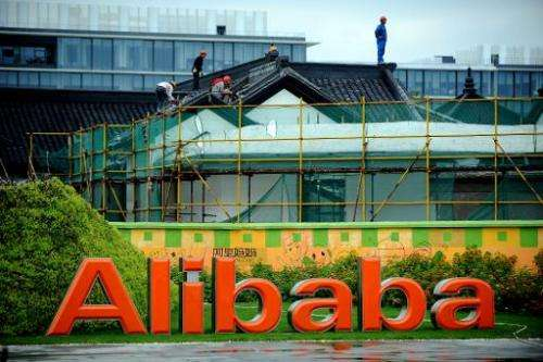 Workers renovate a building at the Alibaba head office in Hangzhou, east China's Zhejiang province on September 15, 2014