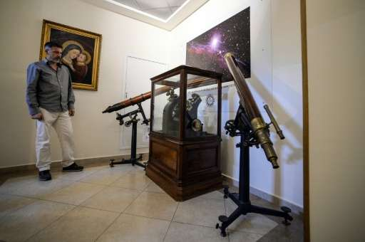 """A man looks at an astronomical telescope at the Vatican Astronomical Observatory, or """"Specola Vaticana"""", in Albano Laz"""