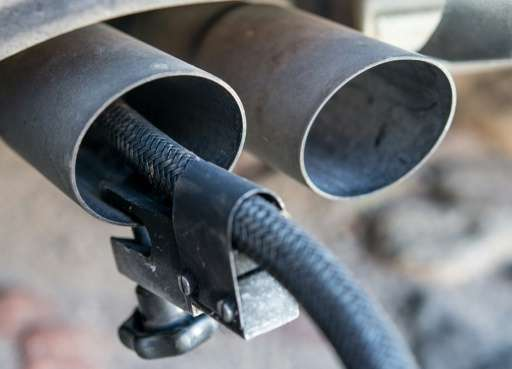 A measuring hose for emissions inspections in diesel engines sticks in the exhaust tube of a Volkswagen (VW) Golf 2,0 TDI diesel