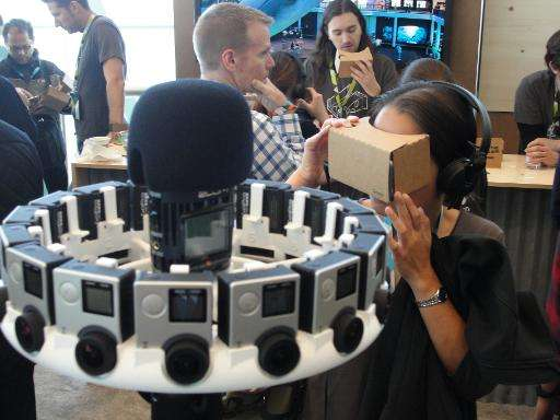 An attendee at Google's annual developers conference checks out cardboard virtual reality head gear, May 28, 2015 in San Francis