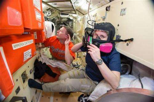 Astronauts back in US side of space station; no ammonia leak