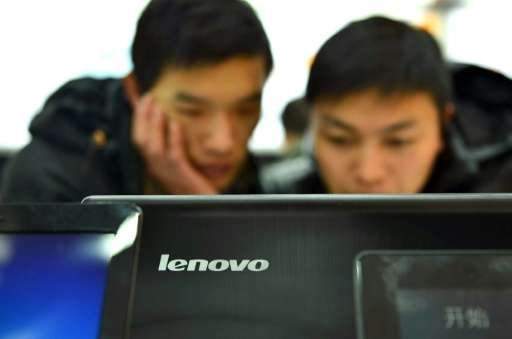 Chinese technology giant Lenovo posts a smaller than expected second quarter loss as sales rise in its mobile business