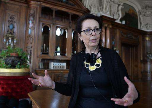 Director Marie Noelle talks to the press during the making of a movie about Maria Sklodowska-Curie in Poznanski Palace in Lodz,