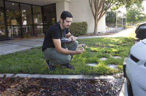 Drought-stricken California ramps up water restrictions (Update)