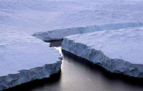 File photo of an iceberg (R) breaking off the Knox Coast in the Australian Antarctic Territory, as seen on January 11, 2008