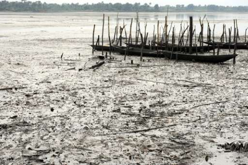Fishing  boats are abandoned on Bodo waterways polluted by spilled crude oil allegedly caused by Shell equipment failure in Ogon