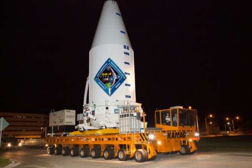 In a handout photo released by United Launch Alliance on December 1, 2015, a transporter moves Orbital ATK's enhanced Cygnus spa