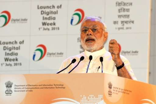 In this handout photograph taken and released by The Indian Press Information Bureau on July 1, 2015, Indian Prime Minister Nare