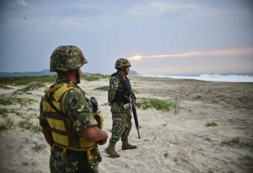 Mexican marines protect the eggs of Golfina turtles from thieves at Morro Ayuta Beach, Oaxaca State, Mexico, on September 10, 20